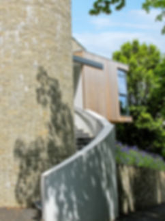 Curved Granite Stone Feature Wall with Timber Clad Triangular Extension