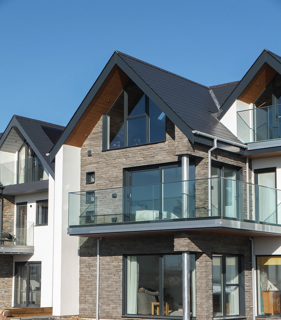 Elevation of Modern Sea Front Property with Gable Window and Frameless Glass Balustrade
