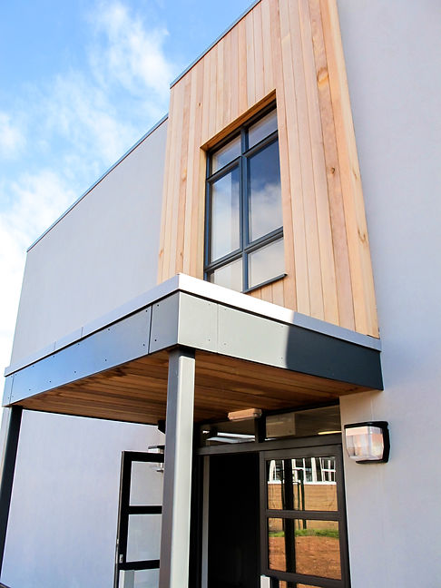 Churston Grammar School Sixth Form Centre Timber Cladding and Dark Grey Window Architectural Detailing
