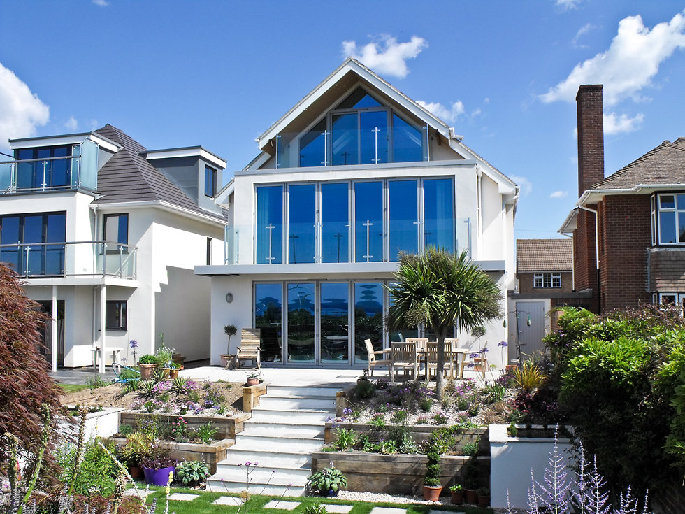 Modern property conversion with fully glazed elevation to enhance the sea views over Stokes Bay in Hampshire