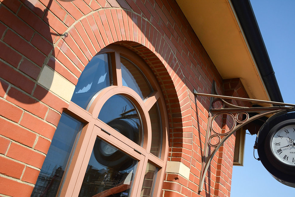Red Brick Arch Detailing Over Heritage Windows at Paignton Steam Train Station Ticket Office