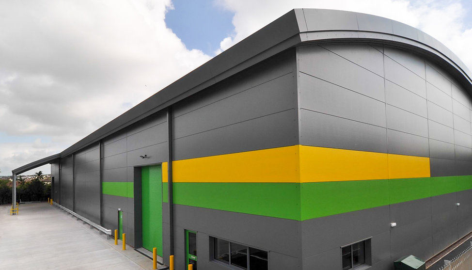 Modern Industrial Unit with Curved Roof and Microrib Cladding in Barnstaple