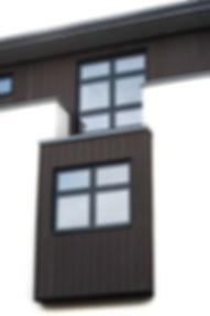 Dark Grey Windows, Crisp White Render, Composite Cladding Architecutral Detailing