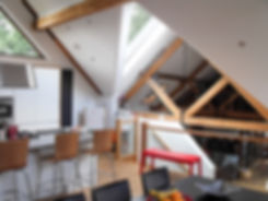 Multi Level Barn Conversion Interior with Exposed Roof Trusses and Rooflights in Hampshire
