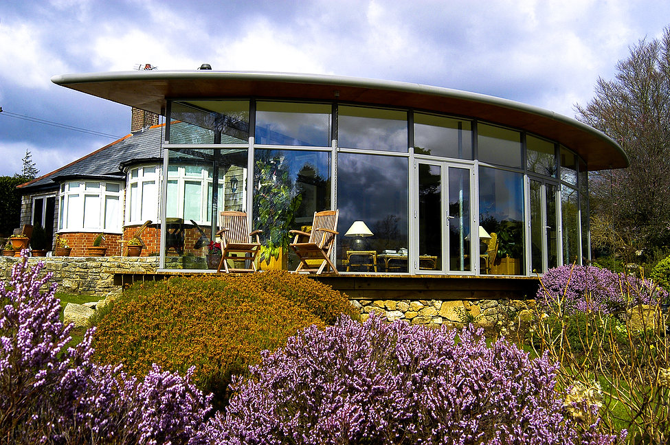 Contemorary Curved Glass House Extension in Dartmoor, Devon