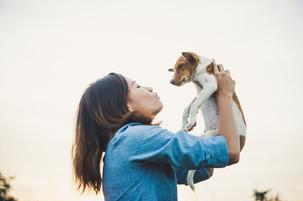 woman-holding-dog-4-e1525442317815.jpg