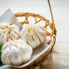 Grilled garlic cloves
