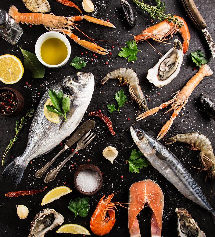 Fresh seafood on black stone, close-up..jpg