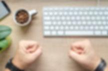 workplace image - fists on desk.jpg