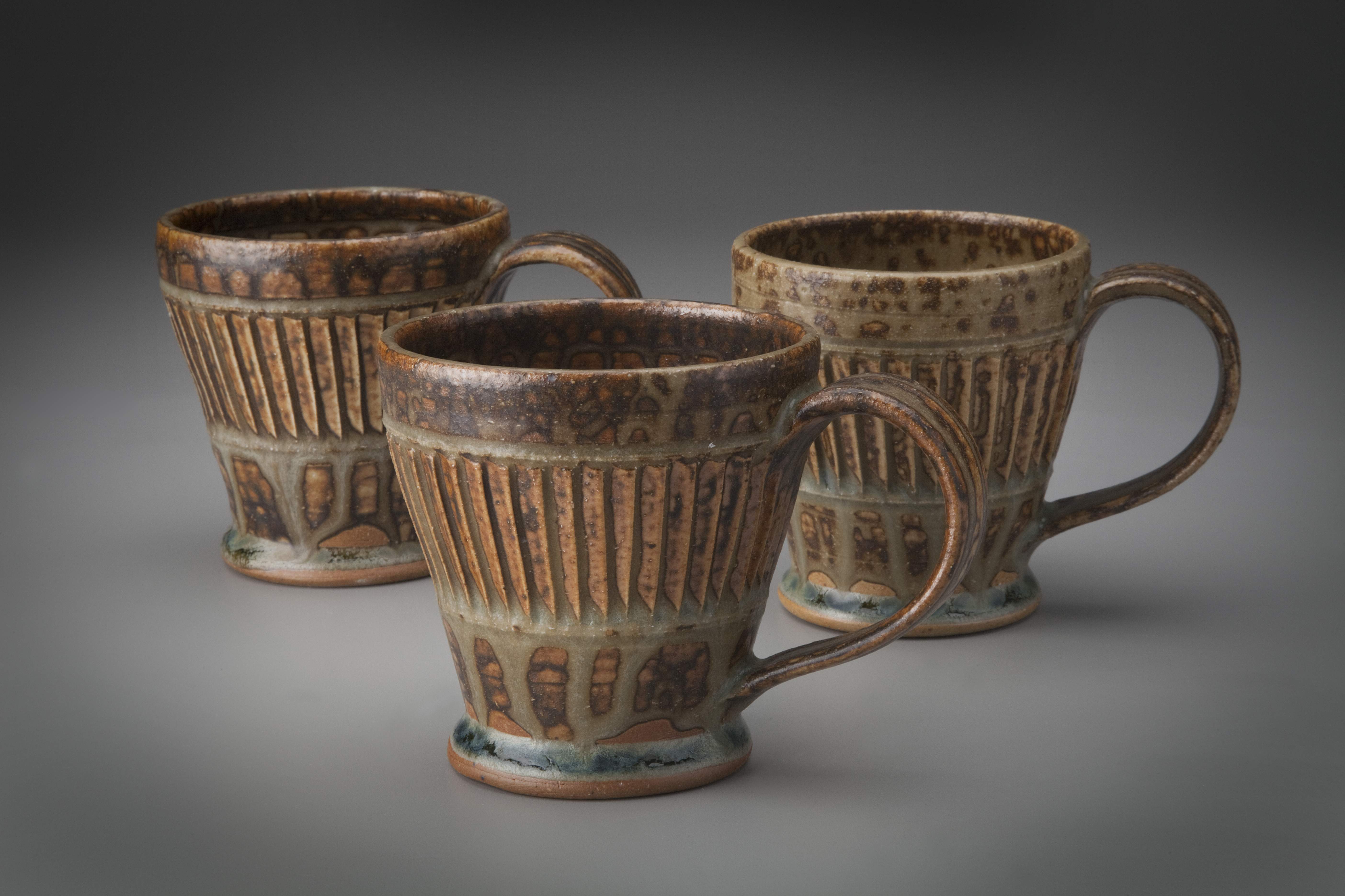 Vertically carved mugs