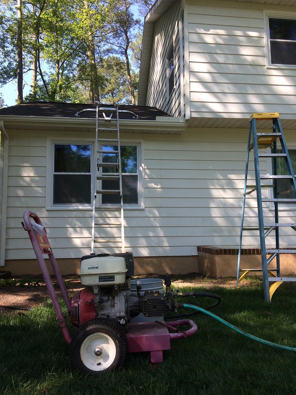 Low pressure wash prior to painting aluminum siding.