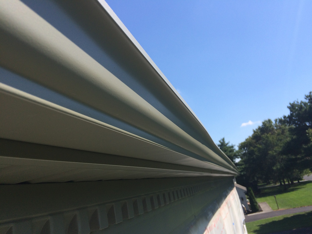 Painted aluminum gutters, soffit and dental molding