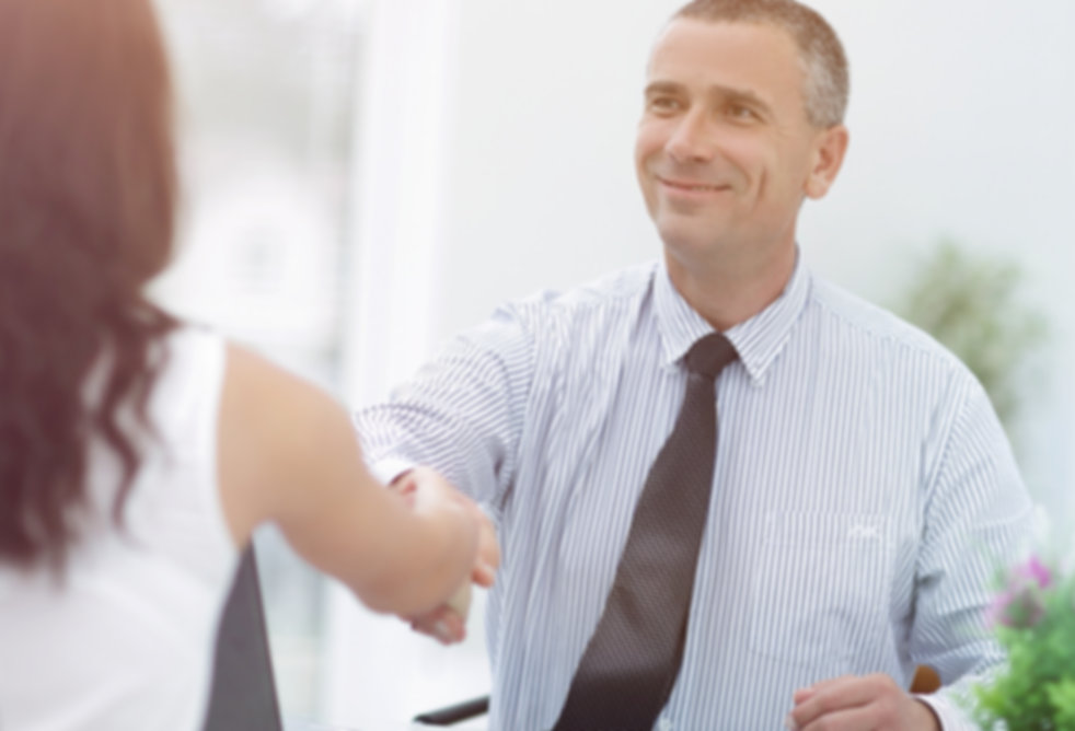 closeup.handshake Manager and client.jpg