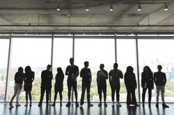 large-group-standing-in-office_4460x4460