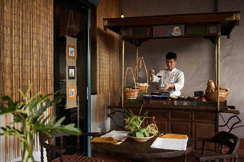 Hospitality photo of chef preparing pho