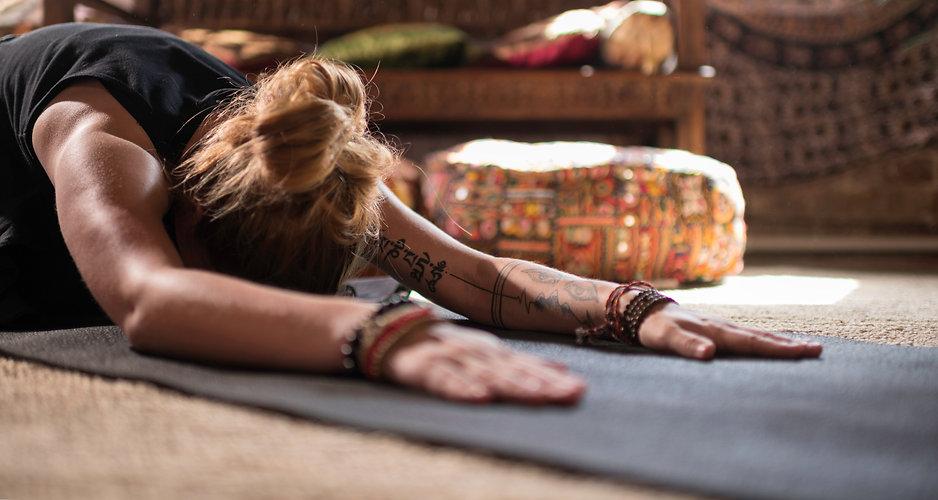 woman-doing-yoga-posture-ZYZTQBP_edited.jpg