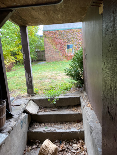 Unoccupied house basement exit to yard