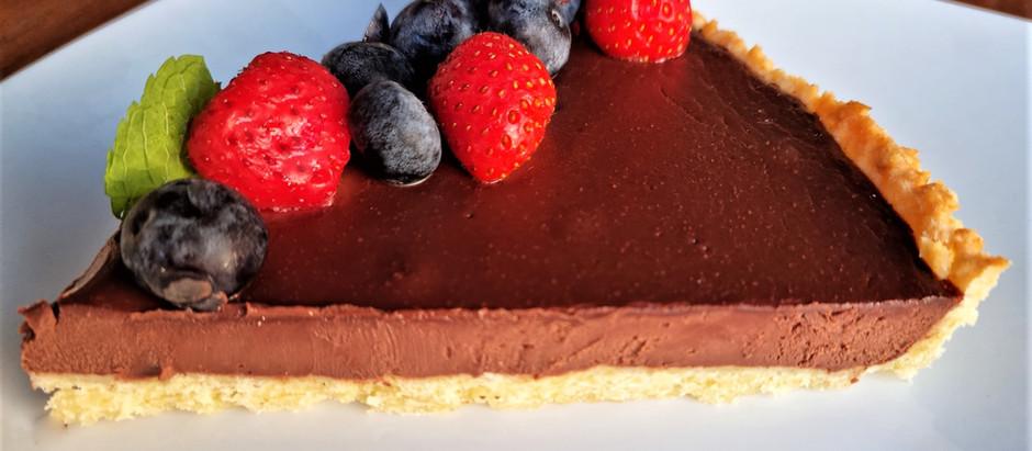 Tarte sablée au chocolat noir et fruits rouges frais : le mariage parfait