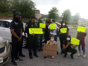 T3 Senior Instructor and Police Chief Kenneth Miller Stands Alongside Protesters