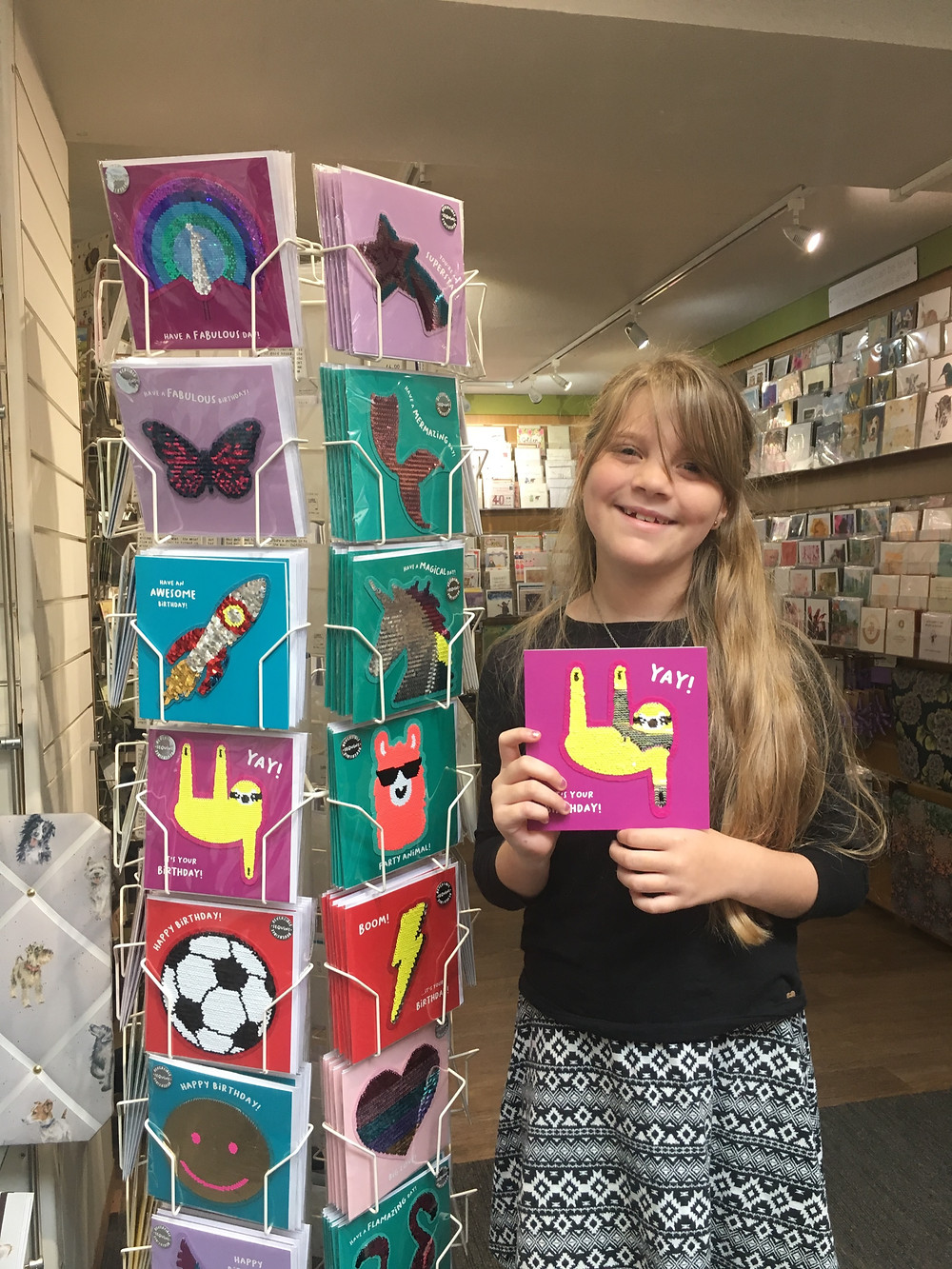 Eden with her favourite product a card
