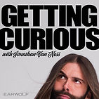 Johnathan Van Ness looks curiously at the title of the podcast.