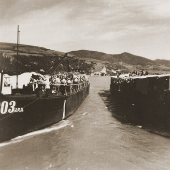 Jewish refugees from the Kladovo Transport are seen onboard two of the three vessels that are transporting them to Sabac.jpeg