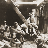 Jewish refugees from the Kladovo transport sit below deck during their journey from Kladovo to Sabac.jpeg