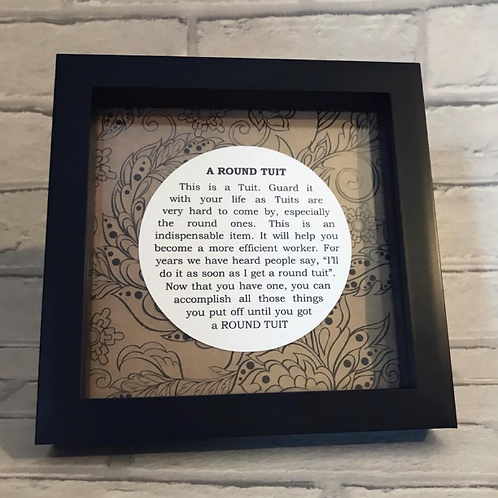 A very rare ROUND TUIT in a beautiful black box frame