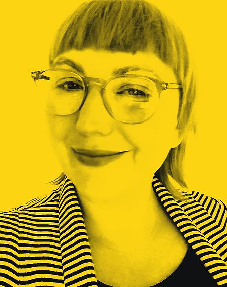 Sadie Phew! Abstract Expressionist Absurdism. Headshot in yellow and black. Absurdist Comedy performer and abstract expressionist visual artist Bristol based