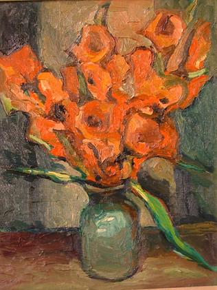 Gladiolas in teal vase