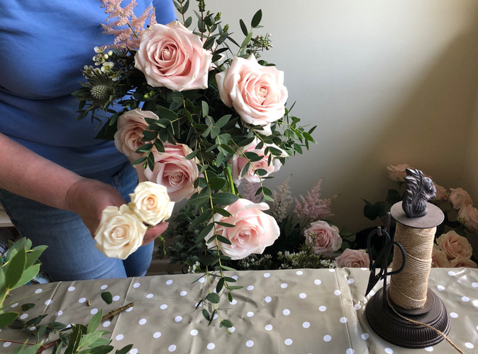 Brides bouquet being created