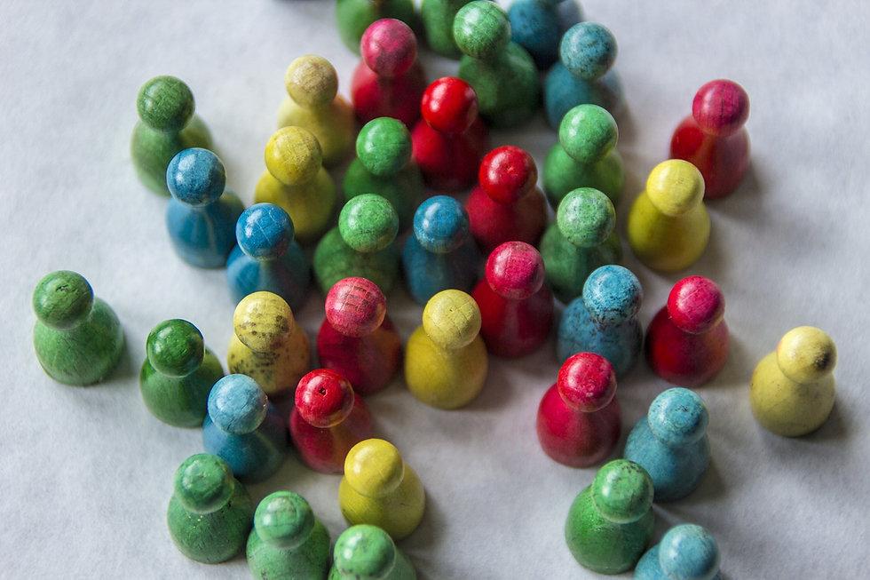 multicoloured wooden skittles
