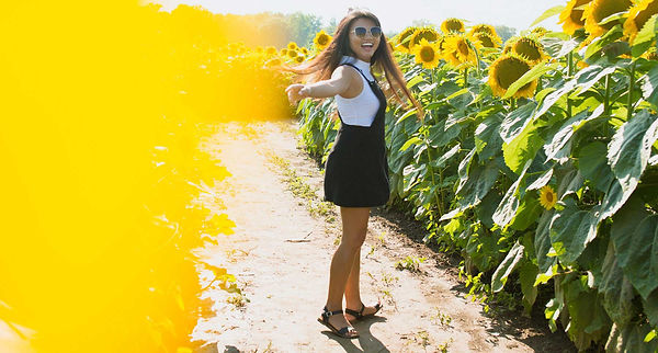 Girl-smiling-in-a-field-of-sunflowers.jp