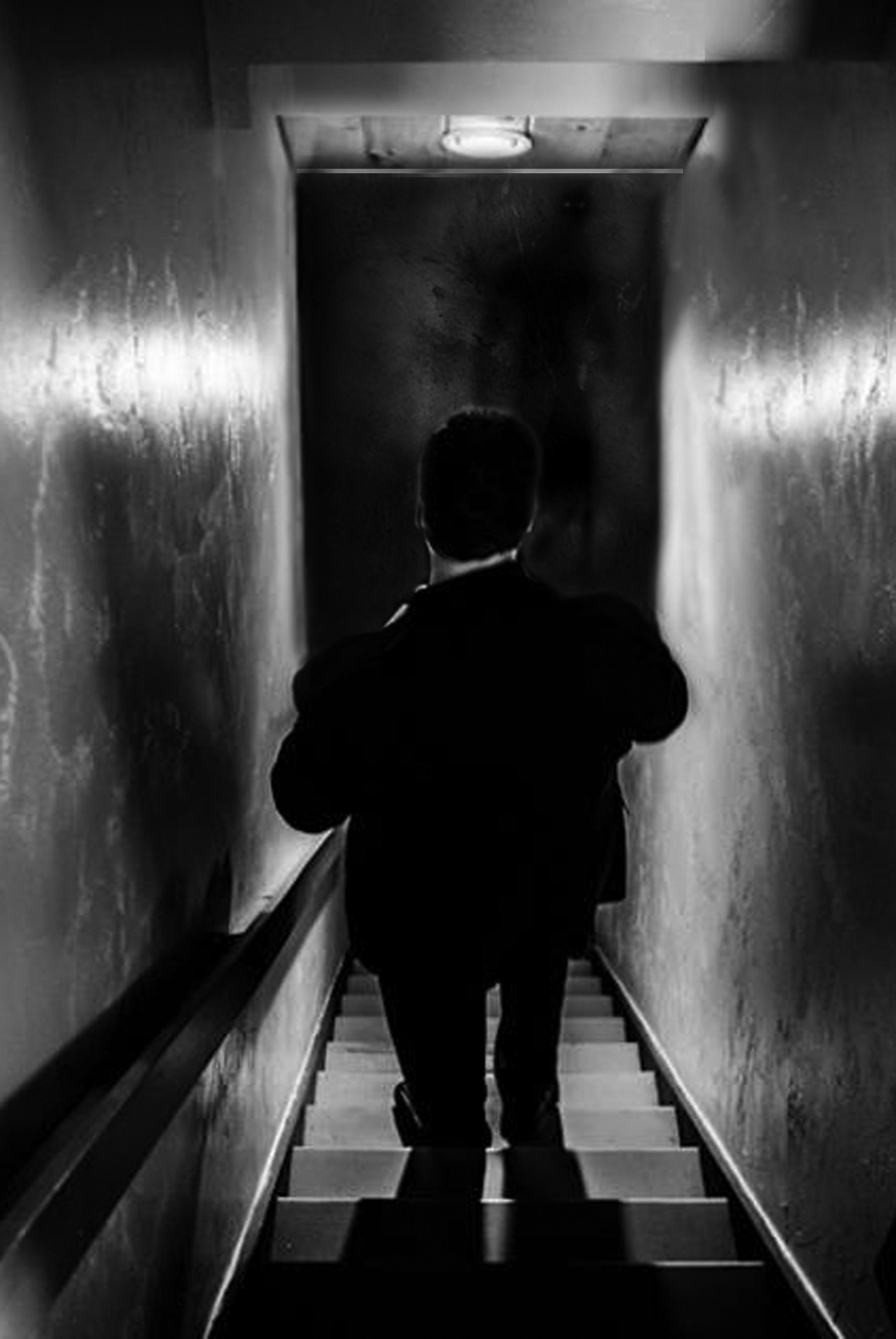 Bill heading down stairs