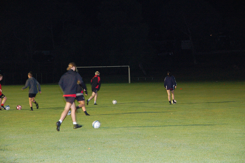 PLayers training under floodlights during Covid19