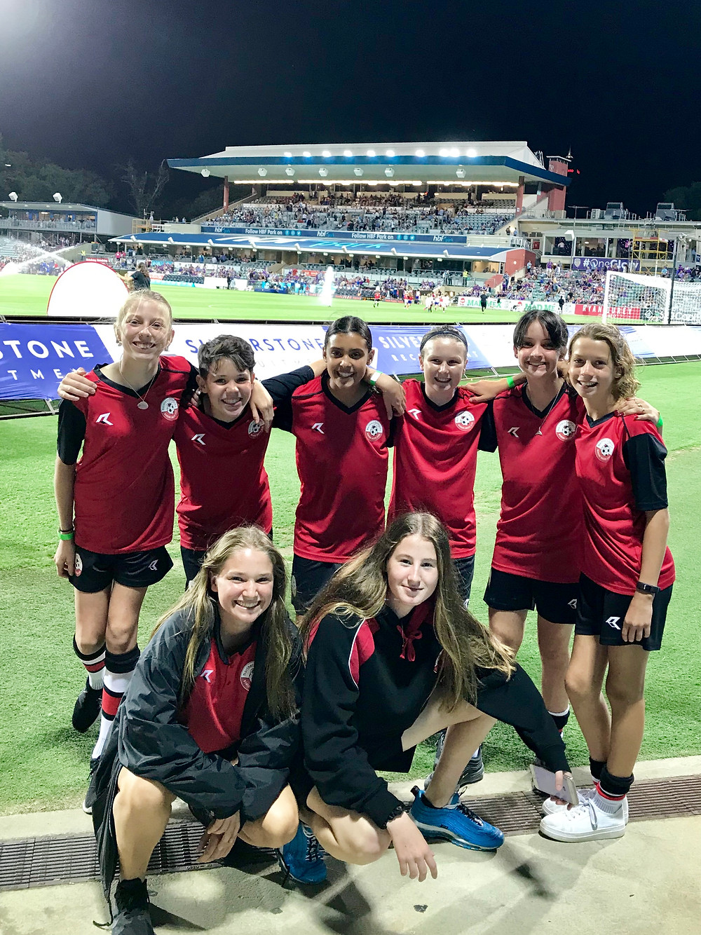 Picture of female junior soccer players at Perth Stadium