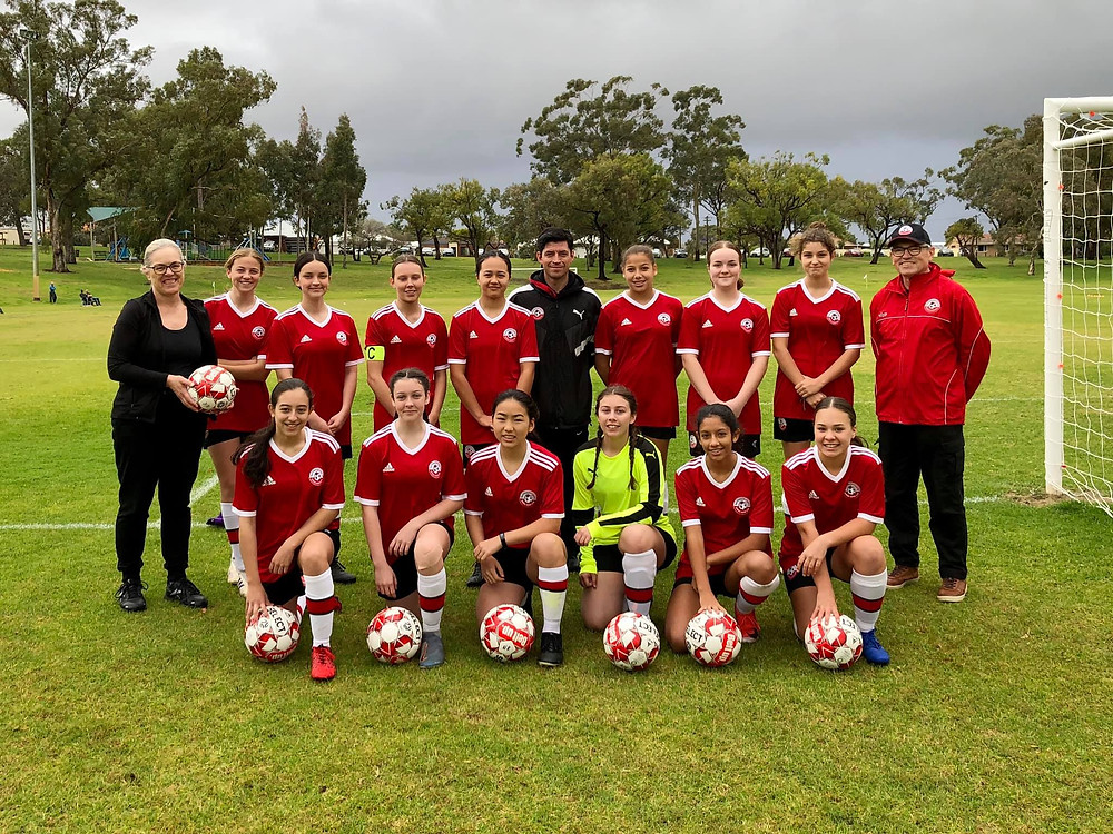 Picture of MLA Janine Freeman with Club President Tony Mullen and our U16's team