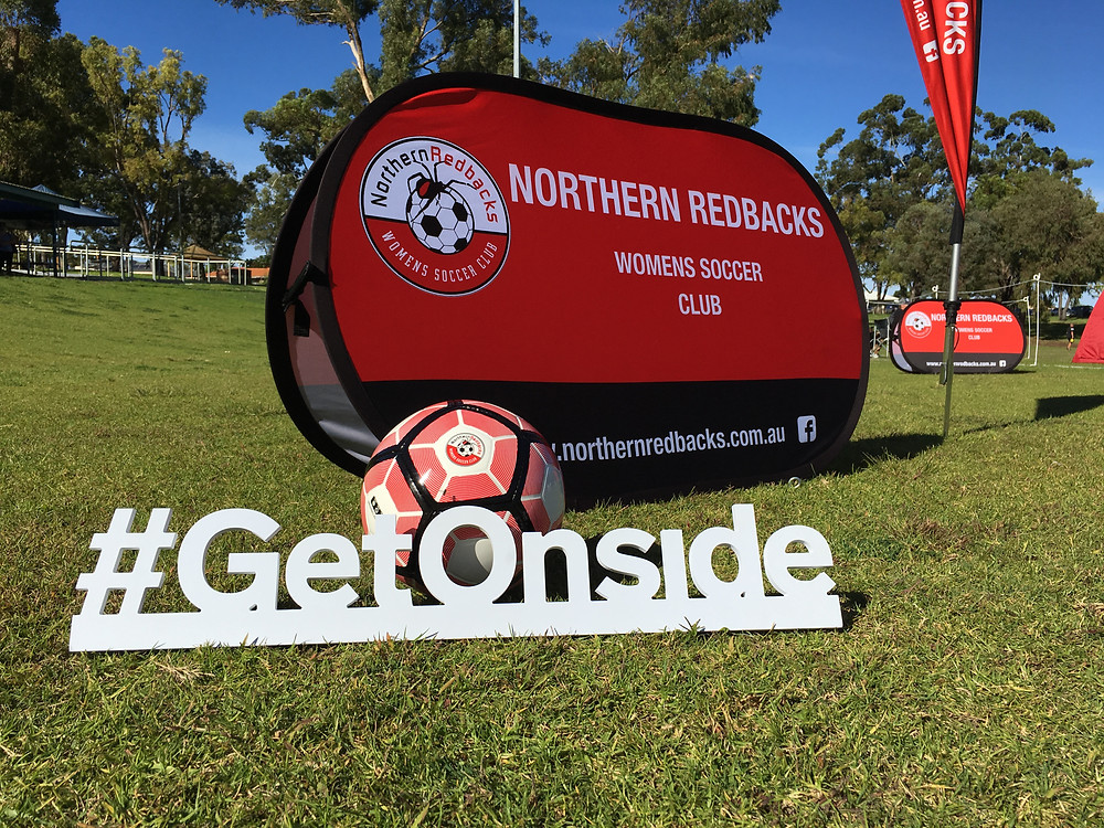 Getonside logo and Northern Redbacks banner at Celebration Park, Balga