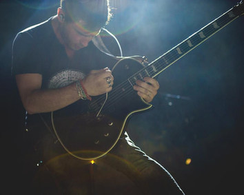 Guitarist Performing Live On Stage