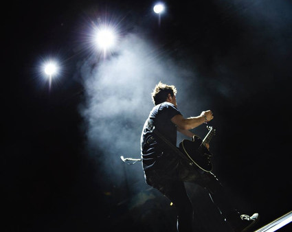 Guitarist Performing Live Onstage