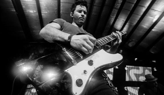 Guitar teacher in Bend, Derek Williams, playing his ESP Phoenix-II