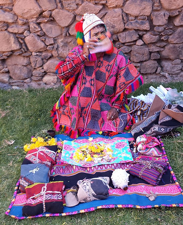 Q'ero Shaman performing despacho ceremony