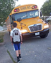 Student with backpack and bus.jpg