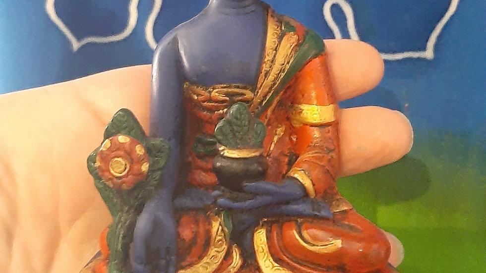 Painted resin buddha