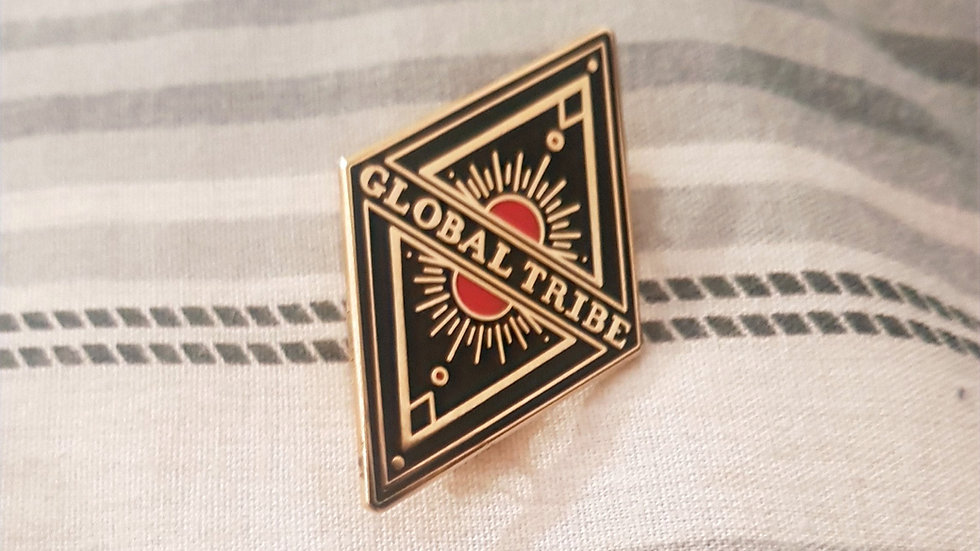 Global Tribe enamelled metal pin 4.5cm x 2.5cm