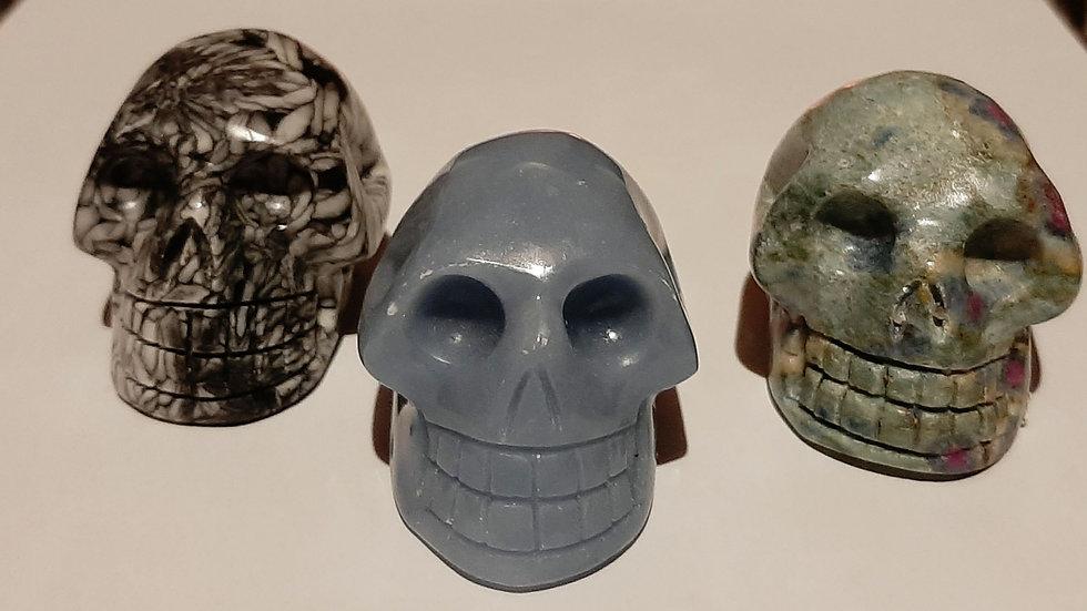 Skulls 5.5cm x 4cm x 4cm Angelite, Chinese writing stone, ruby in fuschite