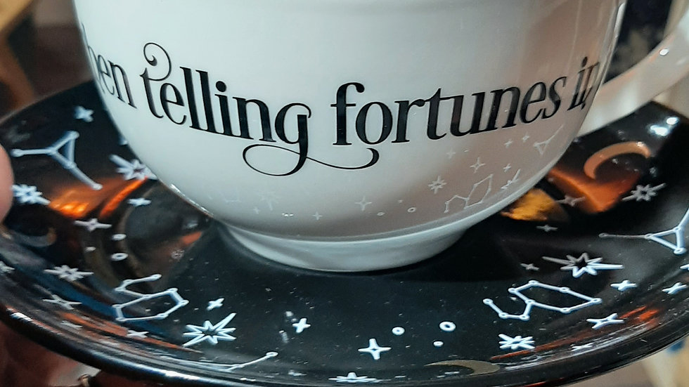 Fortune telling ceramic teacup and saucer