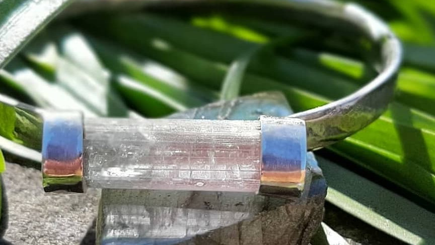 Bi-colour tourmaline set in a textured sterling silver bangle, hand made