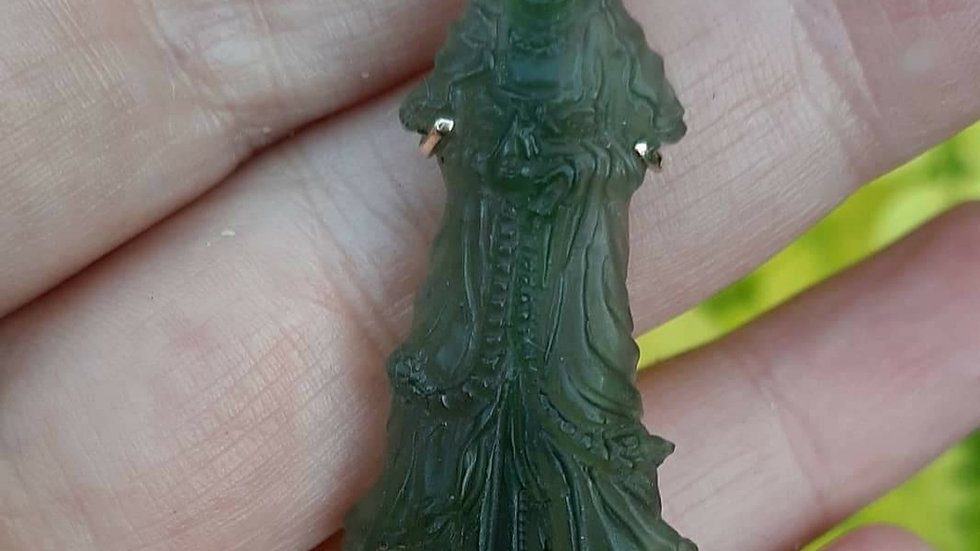 Moldavite carved into Quan Yin set in 9ct yellow gold. One off handmade piece.