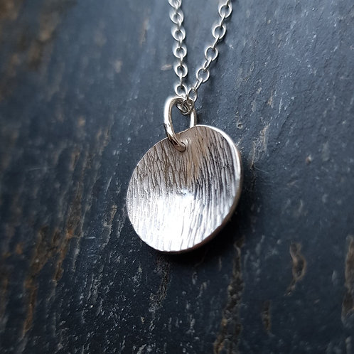 Sterling silver bark texture domed disc necklace